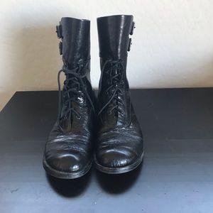 Black lace up combat boots.